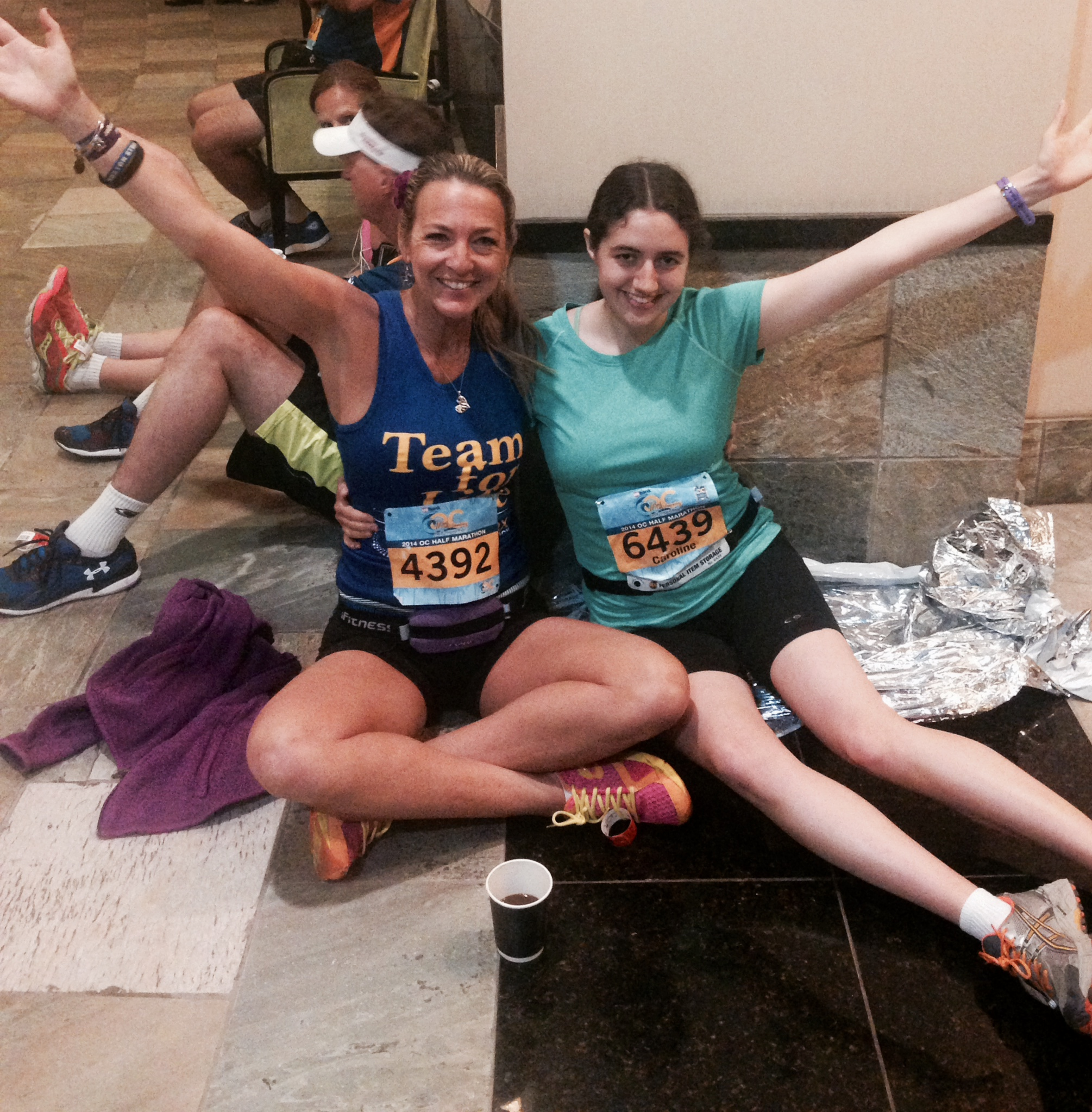 "Here we are before the race, Carolina and I huddling for warmth inside the Marriott hotel.  It was like a party, Smiling and happy.  I asked her what we were going to eat for breakfast before the race, she replied: ""Hills""  and she did.  Sadly, the hills ate me for breakfast :("